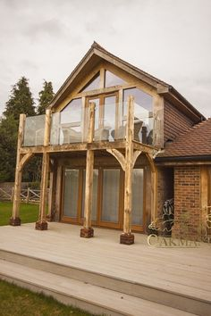Detail of oak balcony with glass balustrade – Glass Balcony Ideas – Balcony Decor Ideas Chalet Extension, Cottage Extension, House Extension Design, House Design, Extension Ideas, Balustrade Balcon, Balustrades, Glass Balustrade, House With Balcony