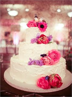 hot pink flowers on a wedding cake