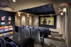 """Wild night"" home theater with leopard-print carpeting and night sky starfield ceiling"