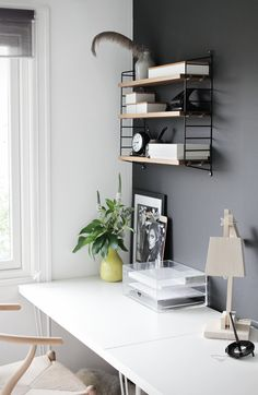 The feather is weird for your context, but the rest seems simple and calm. Maybe painting the current desk would be nice. Calm look and charcoal wall would recede to background.