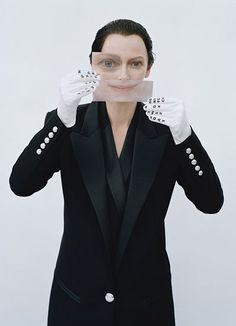 There Tilda goes all one-eyed Illuminati with it. The eye and mouth appear to be a of a different person, which may hint to the concept of programmed alter personality in Mind Control.