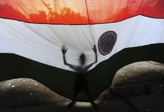 A boy tries to control an Indian national flag from the wind as it is installed at a wholesale market on the occasion of India's Independence Day celebrations. Happy Independence Day India, Year Of Independence, Indian Flag, World 7, India Culture, India People, World Religions, Largest Countries, National Flag