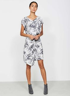 Update your style status in an instant in this smudgy animal printed dress. Featuring a front split with contrasting lining, this effortless piece can take you from day to evening - team with ankle boots and a leather jacket for the epitome of effortless glamour. Model is 5'10n and wears a UK size 10. The length from side neck point to front hem measures 105cm/41.5in.