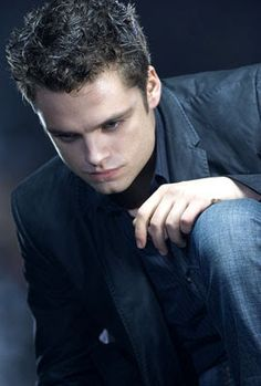 Sebastian Stan (Chase Collins) from The Covenant.He stars in Captain America as Bucky.Also,he's the Mad Hatter in Once Upon A Time.