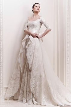 gorgeous half-sleeve lace and silk flowing wedding dress - scalloped lace bodice/neckline, lace half-sleeves, full lace and tulle skirt with scalloped lace top-slit skirt almost like a long full-length peplum... tied together with a gorgeous duchess silk ivory pleated wide sash