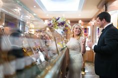 Happy bride and groom sharing Berthillon ice cream in Paris.  Picture taken by Wedding Photographer in Paris, Fran Boloni