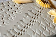 Pasta isn't just an easy dinner idea anymore. When uncooked, these hard shells are the perfect materials for an afternoon craft. Scroll on to read about cute cat necklaces made from macaroni, how pasta can teach kids about the human body and help them discover how to make...