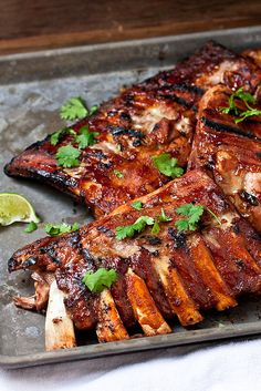 """The grilled, fall-off-the-bone-tender ribs are finished with the """"margarita glaze"""" before they are inhaled by your family and everyone is left staring at you wondering why you didn't make more."""