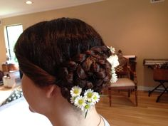 Up do i did with flowers for a christening
