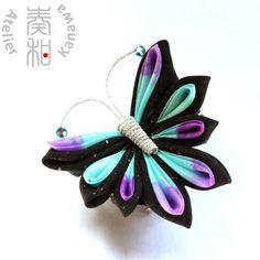Hand Dyed Butterfly Tsumami Kanzashi Hair Clip / Brooch with Aquamarine Swarovski IN ONE PIECE. $59.99, via Etsy.