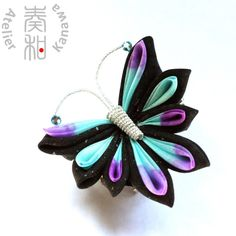 Hand Dyed Butterfly Tsumami Kanzashi Hair Clip / Brooch with Aquamarine Swarovski IN ONE PIECE. $59.99, via Etsy.