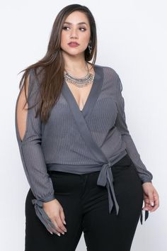 This plus size stretch knit blouse features a v-neckline with a cross wrap style and ribbon accent long sleeves with open slits and ribbon detailing at cuff - April 20 2019 at Looks Plus Size, Look Plus, Curvy Plus Size, Plus Size Women, Curvy Women Fashion, Plus Size Fashion, Womens Fashion, Plus Size Dresses, Plus Size Outfits