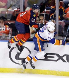 Avoiding the collision:   Florida Panthers defenseman Brian Campbell, left, is checked by New York Islanders left wing Matt Martin during the first period on Nov. 27. -   © Alan Diaz/AP Photo