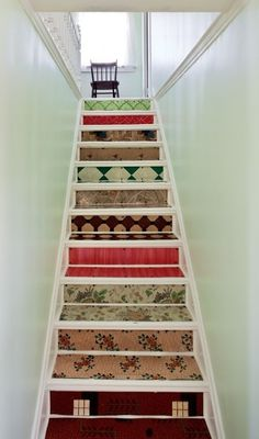 Eclectic carpets on stair risers AND treads.  But on the inside corners, not the outside corners.
