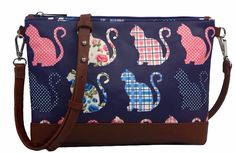 Small crossbody messenger shoulder bag with a cat pattern brown faux leather trim coated canvas matt finish oilcloth style fabric The bag fastens