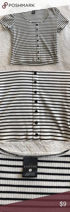 BOGO 50% Off🎉 Black & white striped crop top A black and white crop top from Pacsun. The top has fake buttons up the front with a scoop neck. Armpit to armpit is 15 inches. Top to bottom is 17 inches. PacSun Tops Crop Tops