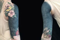 white ink on black tattoo