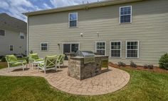 Built in grill with pavers outside our Roosevelt model home in Berewick, Charlotte, NC.
