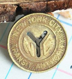 Vintage NYC Subway Token: My father in law was from Brooklyn, NY. I have some of these tokens he had saved from when he lived there. I wear one on a gold chain as a necklace. I absolutely love wearing it every day. It means so much to me :)