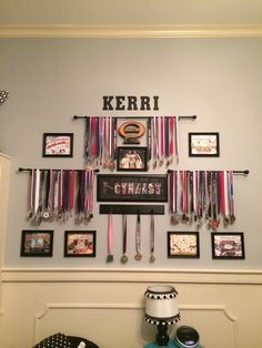 Gymnast medals and score sheets display using curtain rods