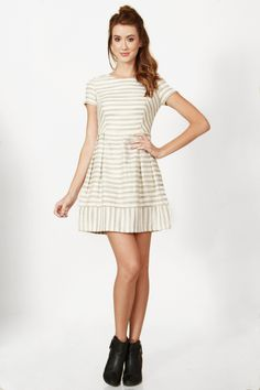 CLEAN LINES DRESS White and grey fit and flare dress. Features a cutout on back. Invisible zipper closure on back.