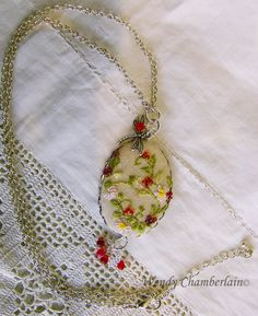 Embroidered pendant necklace.