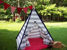 This listing is for a kids handmade play teepee. The teepee is a gray and white stripe, the pole pockets and velcro tie tabs are navy blue. This