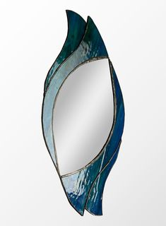 Simple but stunning small mirror design created with lovely textured blue-green glass and copper foil technique. This particular one was sold but if you would like one too you can ...