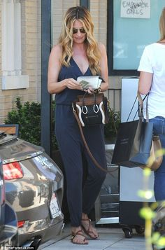 Gorgeous: Deeley looked great in the sleeveless all-in-one as she waited for a valet to br...