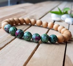 Check out this item in my Etsy shop https://www.etsy.com/listing/522981455/8mm-red-green-chrysoprase-bracelet