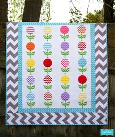 Lollipop Blanket featuring the Chevron Fabric by Riley Blake Designs ~Free pattern! http://www.rileyblakedesigns.com/media/uploads/Free_Quilting_Projects/2012/ChevronLollies.pdf