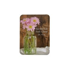 Announce your upcoming nuptials with the charming Mason Jar and Pink Daisies Country Wedding Save the Date Magnet. This quaint custom shabby chic wedding keep the date #magnet features a digitally enhanced floral photograph of a glass canning jar filled with pink daisy flower blossoms and a brown weathered barn wood background. Perfect to set the tone for your casual yet classy rural #country #farm or #rustic #barn, ranch or western #wedding theme. http://www.zazzle.com/loraseverson…