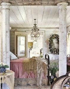 Rustic country bedroom. Like the pillars and aged paint
