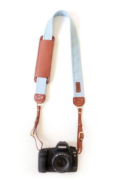 fun (and sturdy) camera strap. Doesn't have to be this exact one though.