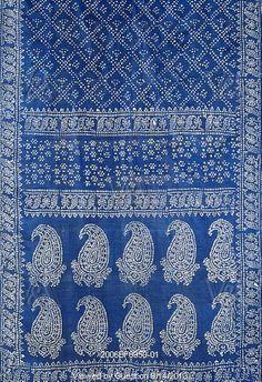 Stenciled patterns on wall like a sari pattern arrangement.  Sari, detail. Benghal, India, 19th century