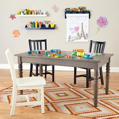 Land of Nod- Our Everlasting Play Table is just what you need. It comes with three different sized legs so it can grow up along with your kids. Plus, each set stores neatly underneath the table itself.