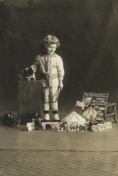 """A little boy with """"Uncle Bill's Big Circus"""" toy."""