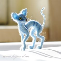 "LYUBA - (miaoo_o) -- ""Blue kosharik"" -- Height: 6 cm., wet and dry felting, Merino wool, copper wire in the ridge, legs and tail, homemade plastic eyes.  -- December 29, 2009."
