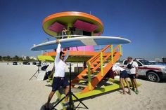 Two new lifeguard towers have been unveiled in Miami Beach. This brightly-colored structure is on the beach at Street. The new round tower's color scheme is ice plant green, fusion pink and knockout orange. Miami Art Deco, Round Tower, Ice Plant, Magic City, Stand Design, Lifeguard, South Florida, Miami Beach, Towers