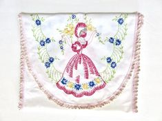 This vintage dresser scarf features a Southern Belle tossing yellow daisies into the air, wearing a beautiful pink bonnet and flowing dress, with blue and yellow flowers around the hem. The same pattern is on both ends of the runner/scarf. The edge is finished in a two-tone pink crochet trim. Vintage Dressers, Vintage Vanity, Antique Items, Vintage Items, Yellow Daisies, Flowing Dresses, Very Lovely, Beautiful, Patriotic Decorations