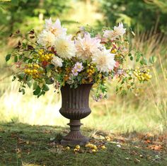 Autumn urn arrangement from using seasonal, sustainably-grown flowers and foliage from our Irish flower farm including cafe au lait dahlias, crab apples and Japanese anemones Japanese Anemone, Flower Farmer, Irish Wedding, Flower Arrangements, Wedding Flowers, Anemones, Dahlias, Seasons, Urn