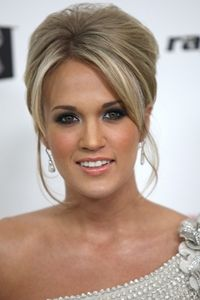 carrie Underwood straight updo bouffant hairstyle with side parting