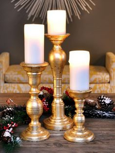 Wood candlesticks, gilded or spray painted.  Wonderful with plain white candles.