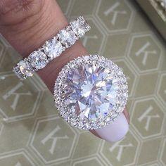 Brilliant round cut diamond engagement ring and diamond eternity wedding band.