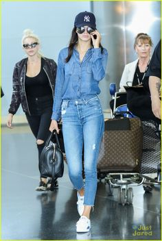 Kendall Jenner goes for a double denim look at JFK Airport on Sunday afternoon (May 3) in New York City.