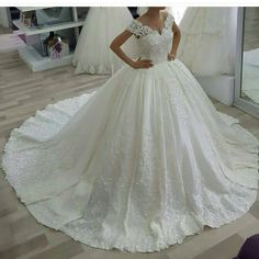 This cap sleeve wedding dress with a ball gown skirt can be recreated with any change a bride wants. Get pricing on custom #weddingdresses & replicas of couture designer gowns that are less than the original when you visit our main website.