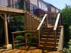 stairs leading to the second level deck uses straight iron railings #Toronto #Deck design #custom deck #landscaping #patio