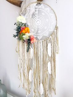 "Dreamcatcher / dream catcher 12 "" diameter. Peonies and ranunculus cascade down one side. Hanging White ceramic feathers"