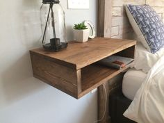 Floating bedside tables with lower cubby shelf. Mounted using traditional French cleat. For reference, the shelf in the photo is finished in #FloatingShelves #HomemadeHouseDecorations,