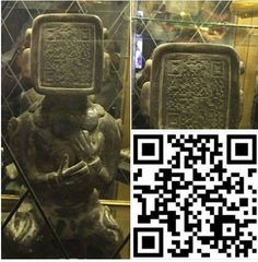 Maya statue with QR code?  No, this is a modern sculpture.  https://www.metabunk.org/decoded-statue-with-a-qr-code-head.t6728/